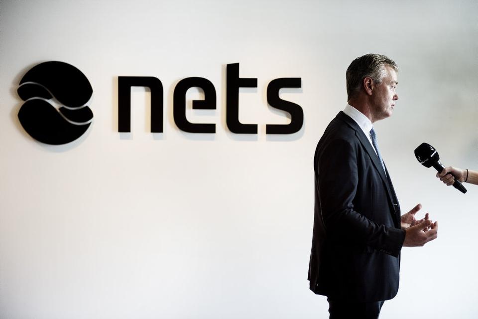 Nets skal have fjernet en række dobbelt-funktioner som følge af en række opkøb, og derfor bliver der 500 færre stillinger. Her ses topchef Bo Nilsson fra da Nets skulle på børsen. (Arkivfoto)