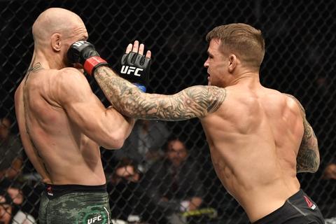 For første gang i karrieren tabte Conor McGregor (til venstre) på teknisk knockout.